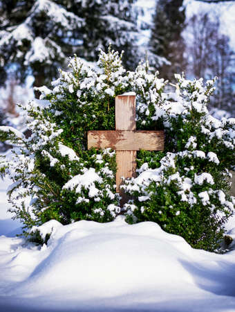tomb empty: crosses at a cemetery in winter Stock Photo