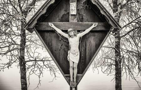 old fashioned sepia: cross in winter - austria