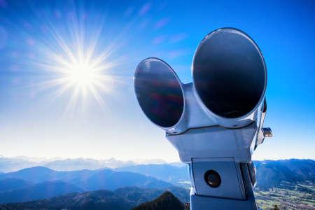 antique binoculars: coin-operated binoculars in front of blue sky