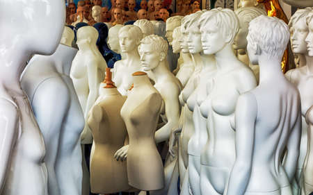 undressed woman: group of old mannequins Stock Photo