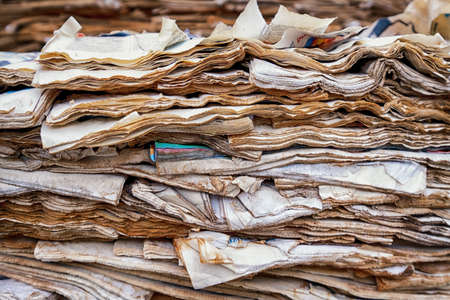 weathered: tower of old weathered newspapers