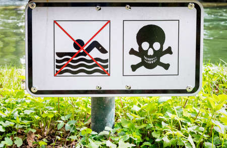 no swimming sign: no swimming sign at a river
