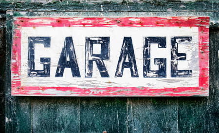 old sign: old garage sign at a wall Stock Photo
