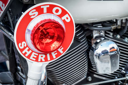 signalling: sheriff signalling disk at a motorbike Stock Photo