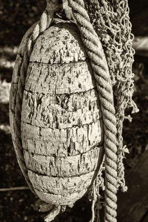 trawler net: old buoy at a harbor Stock Photo