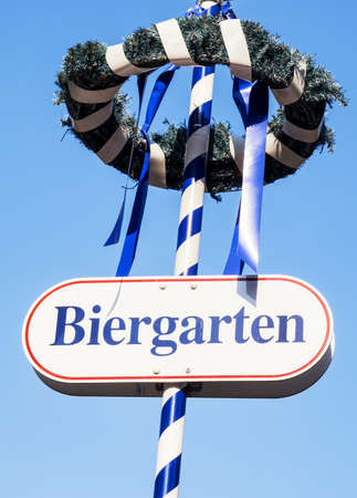 maypole: typical bavarian maypole - closeup - photo - translation: beergarden