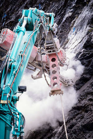 boring rig: working rock drill at a mountain Stock Photo