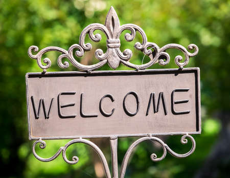 old sign: old fashioned welcome sign - photo