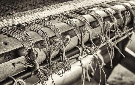 loom: old weaving loom - closeup - photo