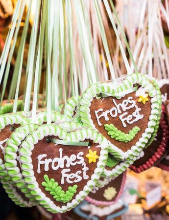 gingerbread heart: typical souvenir at the oktoberfest in munich - a gingerbread heart - lebkuchenherz - translation: merry christmas Stock Photo