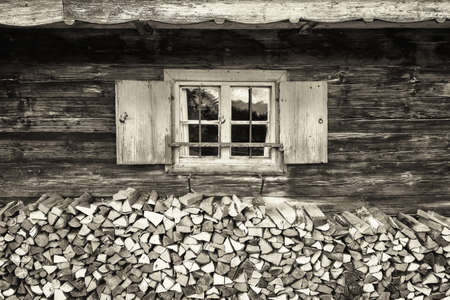 ranch house: old window and firewood