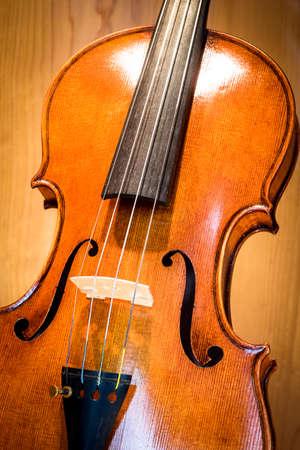 making music: old music instrument - violin - closeup - photo