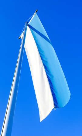 the bavarian flag in front of blue sky