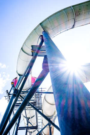 natural gas production: old water slide in front of blue sky Stock Photo