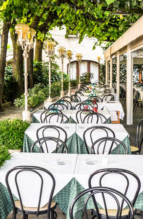 table and chairs at a restaurant in italy Stock Photo
