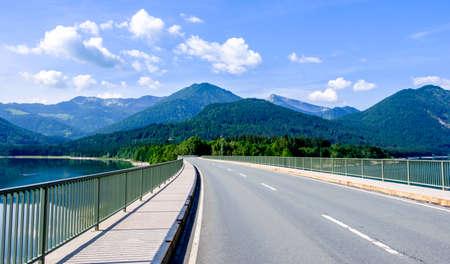 country road at the sylvenstein lake - bavaria Stock Photo
