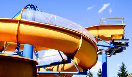 oil and gas industry: old water slide in front of blue sky Stock Photo