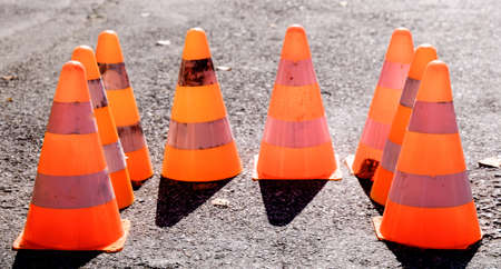 group of traffic cones at a street