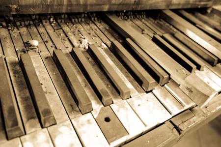 an old broken keyboard of a pipe organ