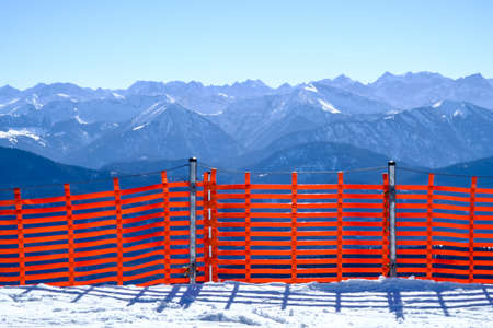fence against snowdrift at the alps