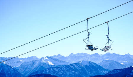 ropeway: mountains with modern ski lift chairs