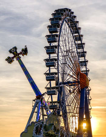 wheel spin: famous ferris wheel at the oktoberfest in munich - germany