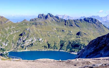 lago di fedaia at the marmolada - the highest mountain at the european dolomites - with reservoir