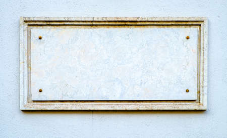 old blank sign at a wall Stock Photo