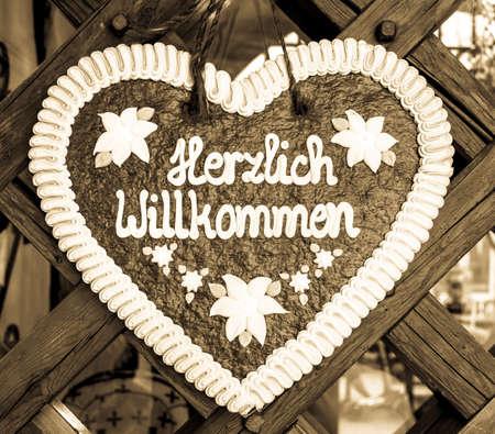typical souvenir at the oktoberfest in munich - a gingerbread heart - lebkuchenherz - translation: welcome