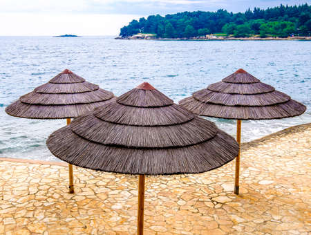 sunbath: typical beach umbrellas in croatia