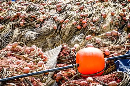 trawler net: buoys and fishing nets at a harbor