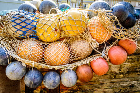 buoys and fishing nets at a harbor