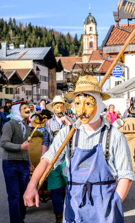fasching: MITTENWALD, GERMANY - FEBRUARY 27: Machkera is a traditional disguise with large wooden larvae, here shown on Feb 27, 2017 in Mittenwald