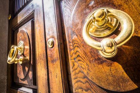 old doorknocker at a door Stock Photo