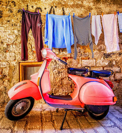 ROVINJ, CROATIA - MAY 9: typical Vespa small motorbike at the old street on may 9, 2017 in Rovinj, Croatia