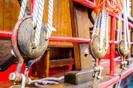 old wooden pulley at a boat