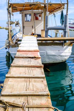 old fishing boat at a harbor Stock Photo