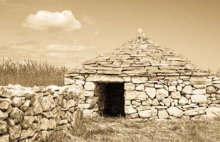 typical stone hut in croatia - kazuni