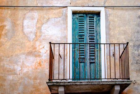 rundown: old balcony at a house Stock Photo