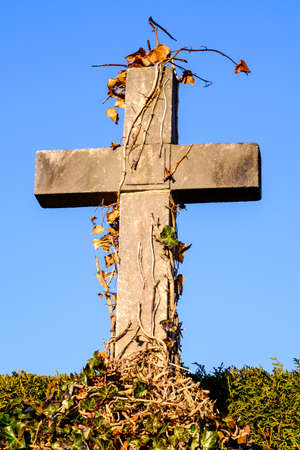 front view: old cross at a cemetery