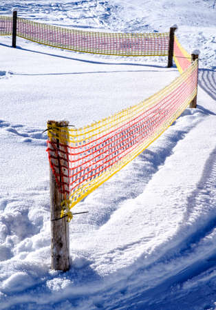 metal grate: fence against snowdrift at the alps