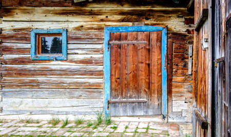 old wooden door at a hut Stock Photo