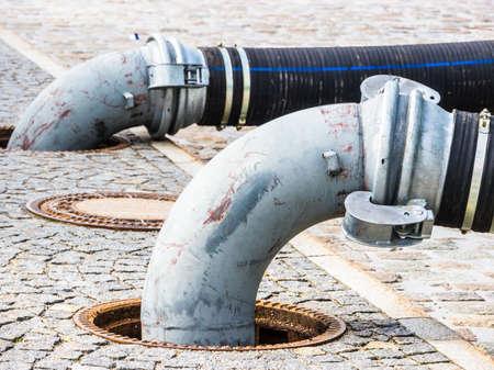 tubes at a sidewalk - photo - closeup