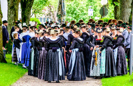 BAD TOELZ, GERMANY - JUNE 12 - People in traditional clothes at the Corpus Christi procession at June 12, 2016 in Bad Toelz - Germany.