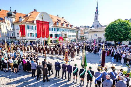 kruzifix: BAD TOELZ, GERMANY - JUNE 15 - People in traditional clothes at the Corpus Christi procession at June 15, 2017 in Bad Toelz - Germany.