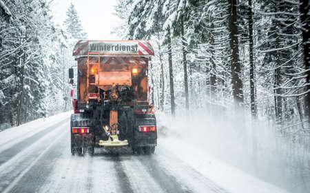 snowplow in winter - austria - europe - german word: winterdienst