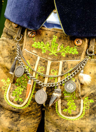 specific clothing: close-up of a typical bavarian krachlederne - traditional clothing with antique coins Stock Photo