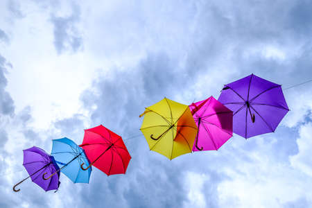 ble: flying umbrellas in front of blue sky