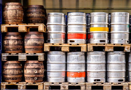 new and old beer barrels