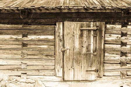 shutter: old wooden door at a hut Stock Photo
